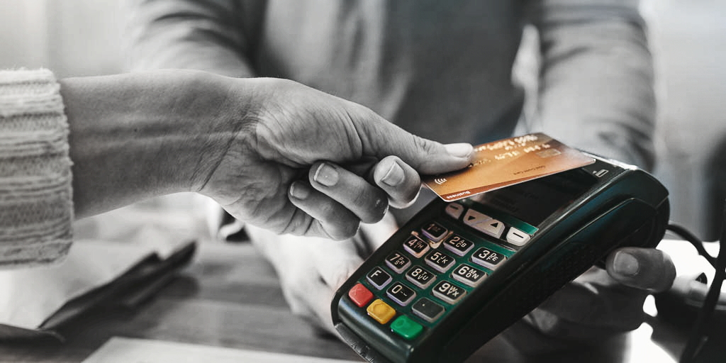 Pharmacist accepting credit card by contactless payment